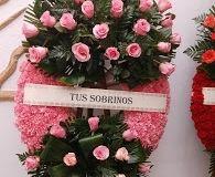 corona de clavel y rosas